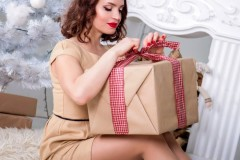 woman-unwrapping-gift-2754746